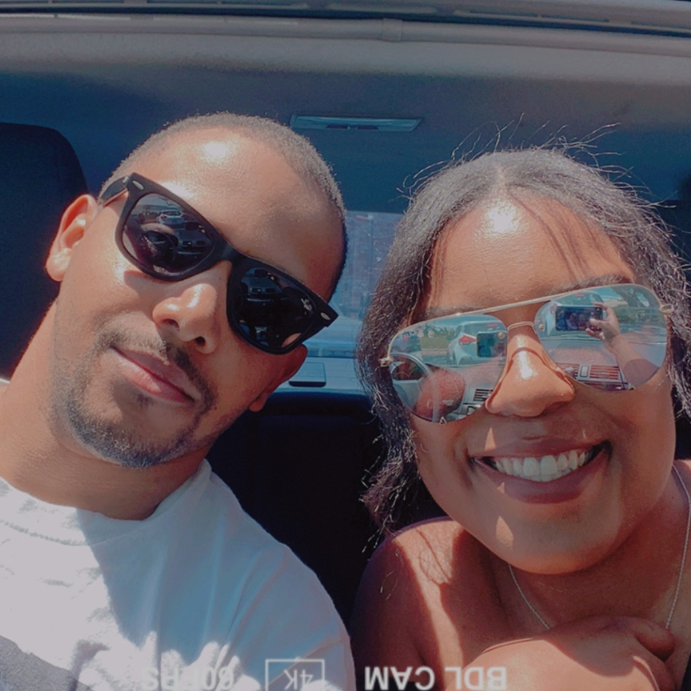DC EASY and his wife take a photo in the car.